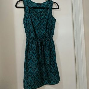 Green and black dress with geometric pattern